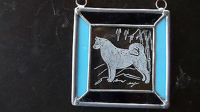 AKITA- Hand engraved Medallion by Ingrid Jonsson