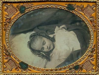 Old Photo. Postmortem - female child with curls
