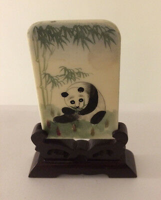 """painting of a Panda eating bamboo on thin stone - Is 5.5"""" tall  with wooden base"""