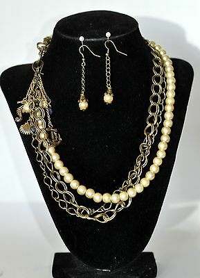 Asymmetrical set brass chain and glass pearl necklace with side hook closure