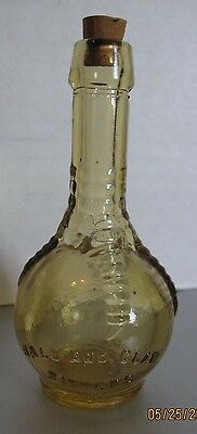 Vintage miniature Amber yellow Ball And Claw BITTERS Bottle