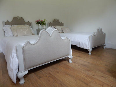 Pair of antique single beds with new upholstery