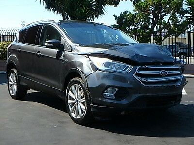 2017 Ford Escape Titanium 4WD 2017 Ford Escape Titanium 4WD Damaged Clean Title Loaded w Options Economical!!
