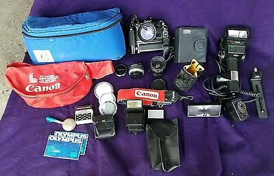 CANON A1 SLR Camera BUNDLE / 50mm F1.4 S.S.C Lens, Motor Drive, Flashes, More!!