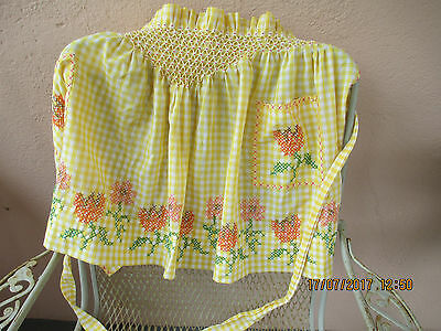 vintage checkered half apron with cross stitch flowers and smocking