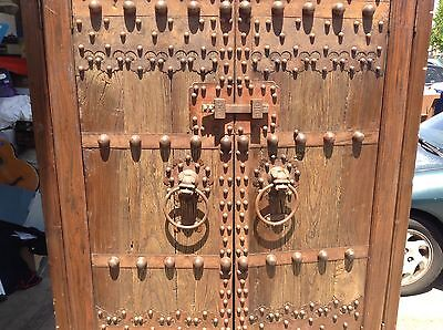 Old or antique Chinese Armoire gated Asian garden temple doors of metal & wood