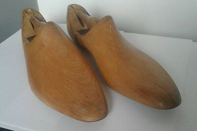 vintage pair of wooden shoe lasts industrial display