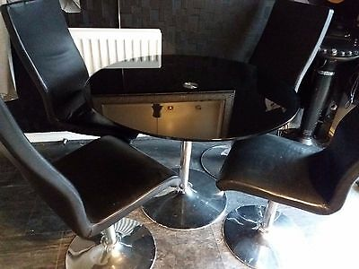 Retro Glass Black Dining Table And Black Leather Swivel Chairs Pic