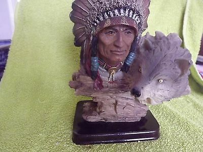 A NATIVE AMERICAN INDIAN CHIEF WITH wolf FIGURiNE