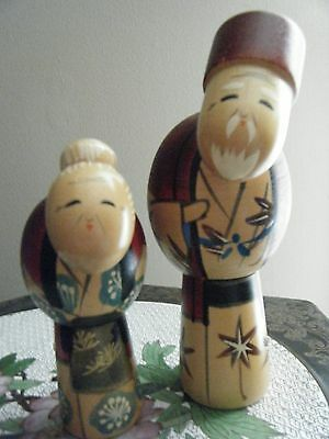 Two Japanese Wooden Dolls Of Elderly Man And Woman.