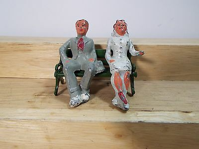 LEAD HAND PAINTED Woman and Man sitting on a bench both dressed for Church??