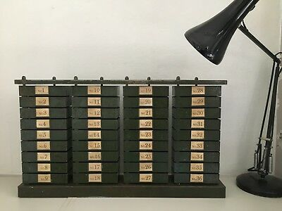 Stunning Vintage Bank of 36 Metal Industrial Swivel Out Small Storage Drawers