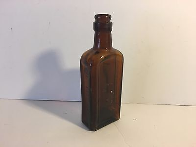 "Antique brown glass bottle.  Great display item.  5.50"" tall"