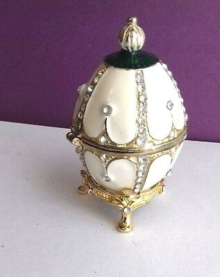 Stunning feberge  egg replica with jade green colour enamel and white and gold