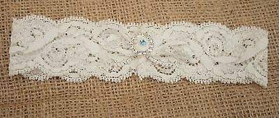 hand made understated Ivory lace wedding garter with  lucky silver sixpence coin