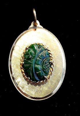 14Kt Gold And Carved Green Jade Pendant