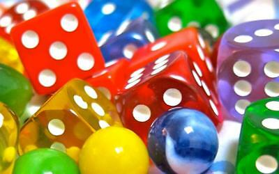 Old Photo.  Close-up of Colored Dice & Marbles