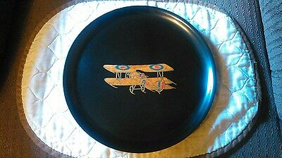 Couroc collectible plate with wooden biplane