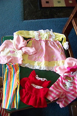 Lot of clothes for a small baby doll