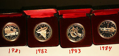 Lot of 7 CANADIAN SILVER DOLLARs IN CASE, 7 different dates 1981 thru 1887
