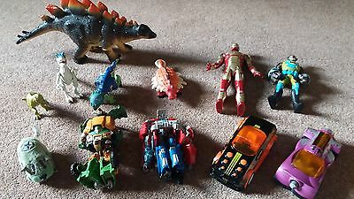 Selection of mixed boys toys. Cars dinosaurs transformers action figures bundle