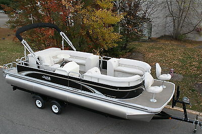 New 25 ft pontoon boat with 115 four stroke Mercury and trailer