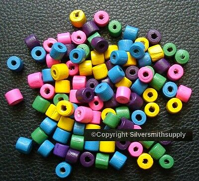 "100 7x6mm  Wood drum beads assorted colors 1-2mm hole 25"" When Strung WB013"
