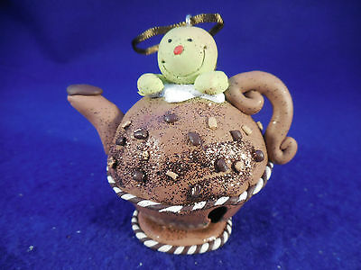 snowman on teapot sleigh bell ornament metal and clay 3""