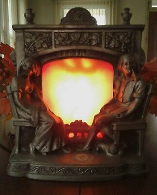 Vintage Metal Fireplace - Man and Woman Seated At Fireplace Motion Lamp - Pewter
