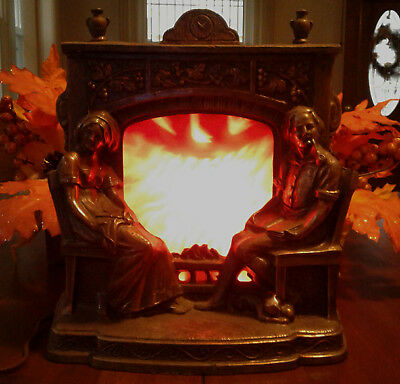 Vintage Metal Fireplace - Man and Woman Seated At Fireplace Motion Lamp