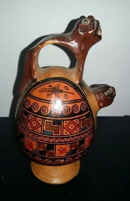South American clay porcelain jug vase with jaguar figures hand painted