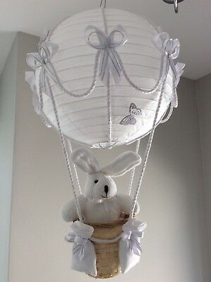 John Lewis toy in a hot air balloon in white and silver