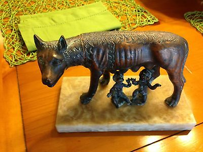 Capitoline Wolf - She-wolf Bronze statue Romulus Remus on Marble