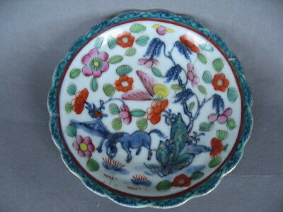 Small 18th C. Chinese saucer, clobbered decoration. Horse  in underglaze blue.