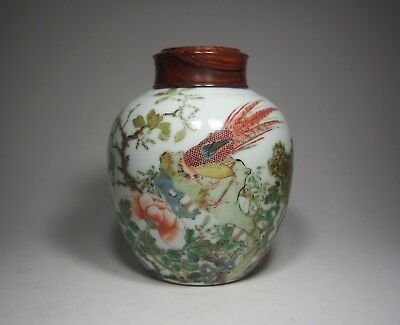 A Famille-Verte 'Phoenix' Jar with Wooden Cover
