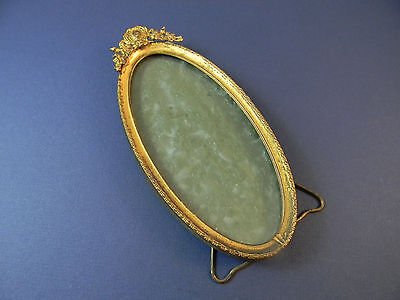 Vintage brass oval frame withglass, stand, and fancy crest