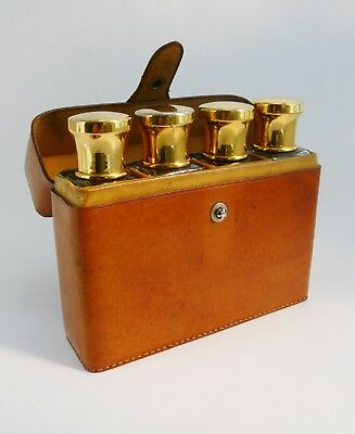Antique early 20th century gentleman's travelling set of 4 bottles leather case