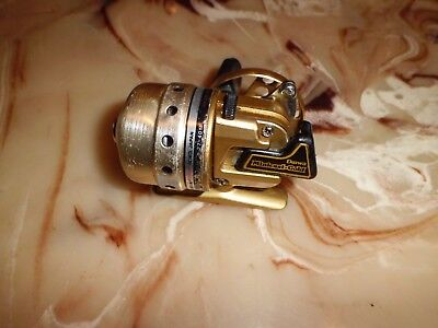 Vintage Daiwa Minicast Gold Spincasting Reel made in Japan