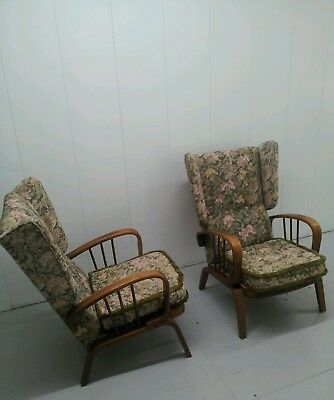 A pair of 1950s bentwood wingback chairs mid century pair of vintage armchairs