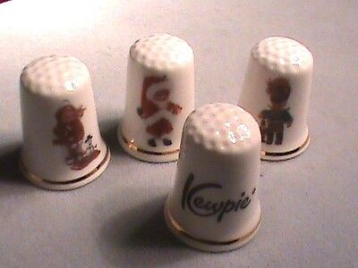 VINTAGE PORCELAIN KEWPIE THIMBLES Gimbel and Sons made in England LOT OF 4 MINT