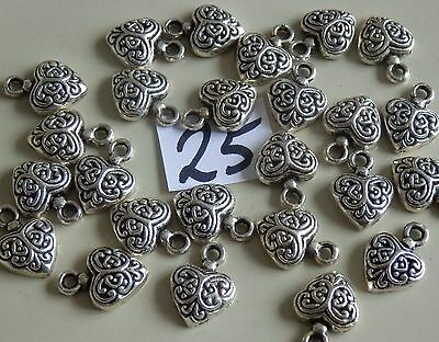 * 25 *.Heart charms.14mm.Vintage bright silver colour metal beads.4mm Hanger
