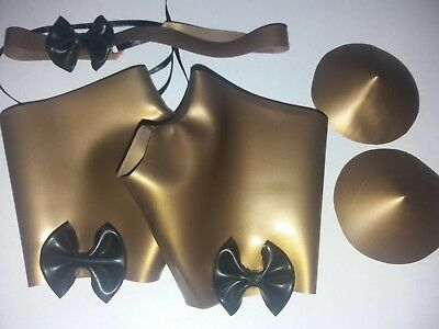 Gold and black rubber dress up set with glove mitts, pasties and collar