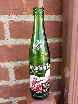 "Vintage Mountain Dew Bottle 10oz  ""Sold By Cleo And Jimmie"""