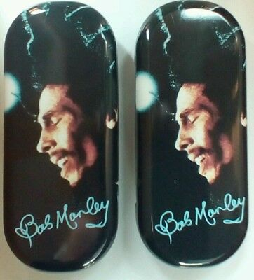Two Sets Of Bob Marley Metal Glasses Cases.