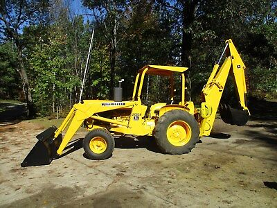 John Deere 302a backhoe new engine  ( I can deliver for a fee)