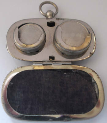 Chrome gold Sovereign (?) holder; looks to be in good working condition