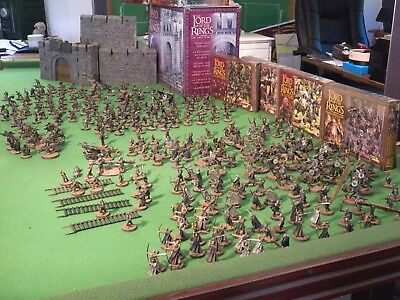 Painted Lord of the Rings Warhammers with limited edition Helms Deep fortress