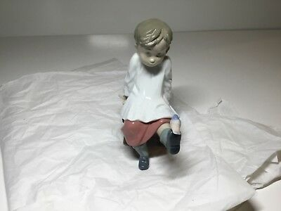 Lladro Talk to Me Choir Boy with Bird in Chair Figurine Gloss Finish 5987