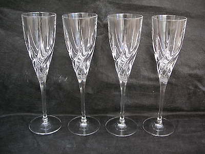 4 tall champagne glasses with swirl pattern