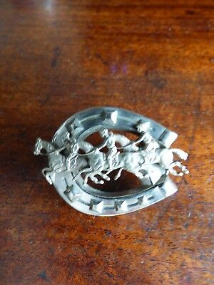 A Silver Horse Shoe Brooch With 3 Riders